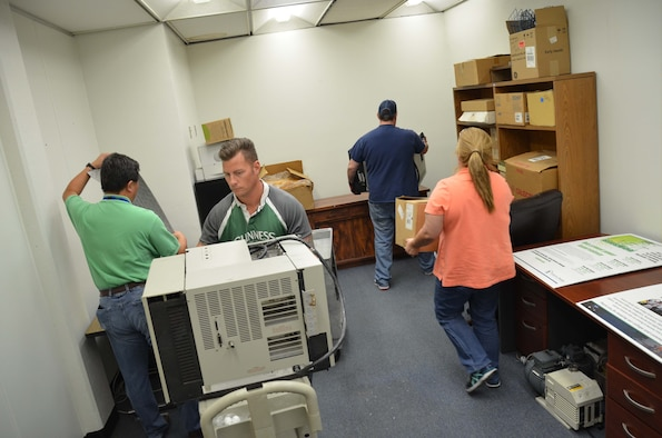 Members of the Air Force Technical Applications Center and faculty from Eastern Florida State College position newly-procured laboratory analysis equipment from an anonymous Central Florida donor to the college March 17, 2017.  AFTAC personnel were asked to assist the school with ensuring the equipment was functional and operable.  Pictured from left to right:  Dr. Zhengrong Lee, Brett Maptson, Bart Scarbro and Maria Fraley.  (U.S. Air Force photo by Susan A. Romano)