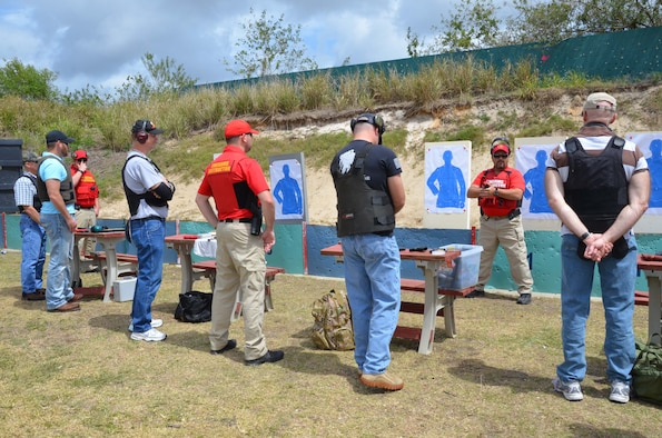 Members of the Air Force Technical Applications Center, Patrick AFB, Fla., listen to master lead instructor Larry Plotkin (second from right) give instructions on how to stand during the live fire portion of the Brevard County Sheriff's Office's Self Defense Through Tactical Shooting and Decision Making course March 25, 2017. (U.S. Air Force photo by Susan A. Romano)