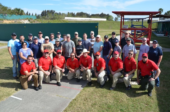 Members of the Air Force Technical Applications Center, Patrick AFB, Fla., and deputies from the Brevard County Sheriff's Office pose for a group photo after completing BCSO's Self Defense Through Tactical Shooting and Decision Making course March 25, 2017.  (U.S. Air Force photo by Susan A. Romano)