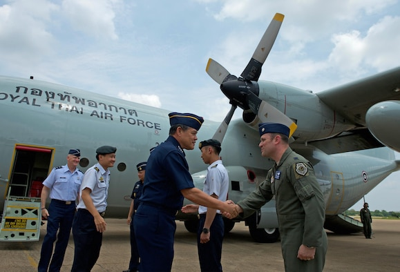 U.S. Air Force Lt. Col. James McFarland, exercise director for the U.S. Air Force greets Royal Thai air force (RTAF) Air Chief Mashal Surasak Toongtong, Chief of the Air Staff for the RTAF during his arrival to the closing ceremony for Cope Tiger 17 at Korat Royal Thai Air Force Base, Thailand, March 31, 2017. The annual multilateral exercise is aimed at improving combined combat readiness and interoperability between the Republic of Singapore air force, Royal Thai air force, and U.S. Air Force, while concurrently enhancing the three nations' military relations.  (U.S. Air Force photo by Staff Sgt. Kamaile Chan)