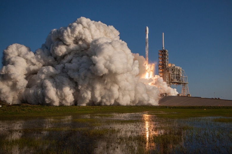 SpaceX made history March 30, 2017 with the successful launch of a reused Falcon 9 rocket from Launch Complex 39A (LC-39A) at NASA's Kennedy Space Center in Florida at 6:27 p.m. EDT. One hour prior to the milestone launch, Citizen Airmen from the 920th Rescue Wing were clearing the box beneath the rocket's path in an HH-60G Pave Hawk helicopter ensuring no mariners were in harm's way prior to launch. (Photo courtesy Spacex)