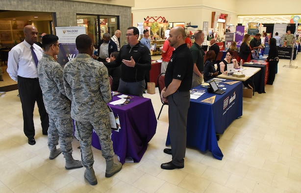 Keesler personnel attends the Spring Education Information Fair at the base exchange, March 29, 2017, on Keesler Air Force Base, Miss. The Keesler Education Services' staff hosted more than 25 community colleges and universities at the event. (U.S. Air Force photo by Kemberly Groue)