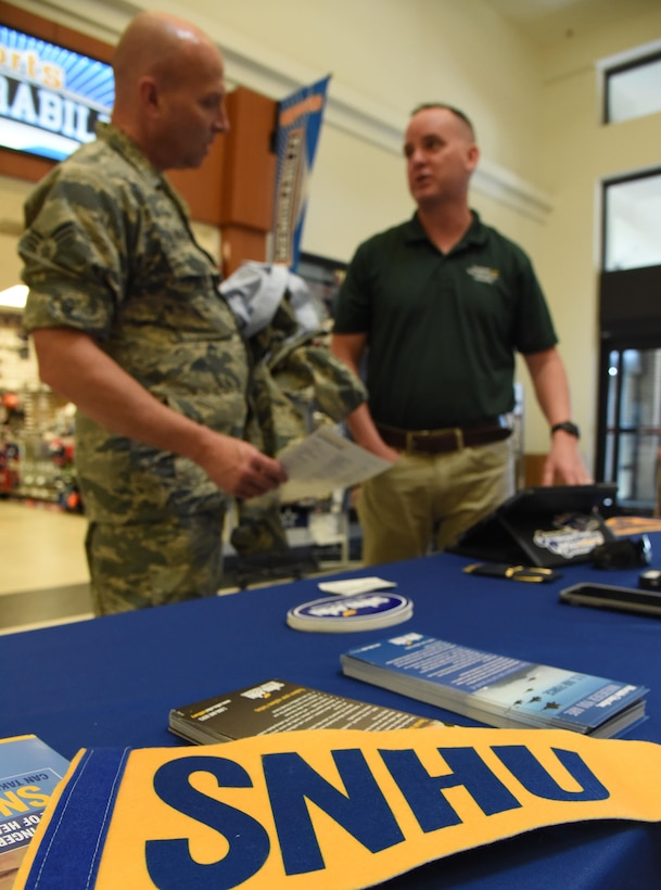 A Southern New Hampshire University  flag and brochures sit on display during the Spring Education Information Fair at the  base exchange , March 29, 2017, on Keesler Air Force Base, Miss. The event is held to allow Keesler personnel the opportunity to explore higher education options. (U.S. Air Force photo by Kemberly Groue)