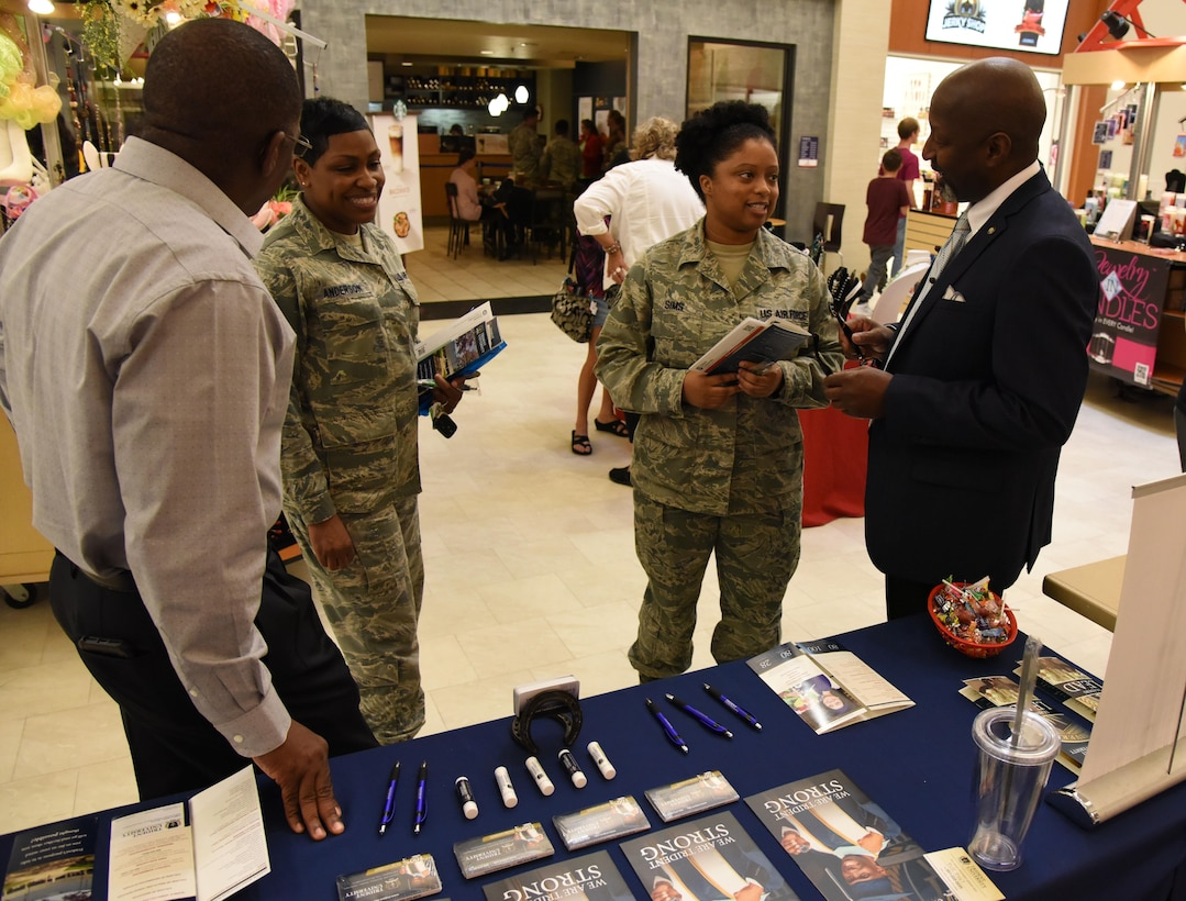 Keesler personnel attend the Spring Education Information Fair at the base exchange, March 29, 2017, on Keesler Air Force Base, Miss. The event is held to allow Keesler personnel the opportunity to explore higher education options. (U.S. Air Force photo by Kemberly Groue)