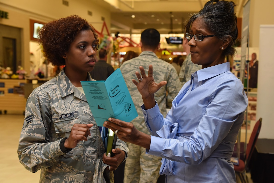 Lutrician James, Base Operations Support education and training specialist, provides information to Senior Airman Adrienne Gordon, 81st Dental Squadron dental lab technician, during the Spring Education Information Fair at the base exchange, March 29, 2017, on Keesler Air Force Base, Miss. The event is held to allow Keesler personnel the opportunity to explore higher education options. (U.S. Air Force photo by Kemberly Groue)