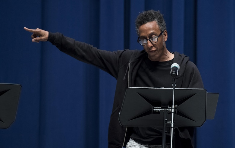"""Andre Royo, actor, preforms during a scene of, """"Jesus Hopped The 'A' Train,"""" March 20, 2017, at Yokota Air Base, Japan. For the performance Royo played the role of Lucius Jenkins. (U.S. Air Force photo by Airman 1st Class Donald Hudson)"""