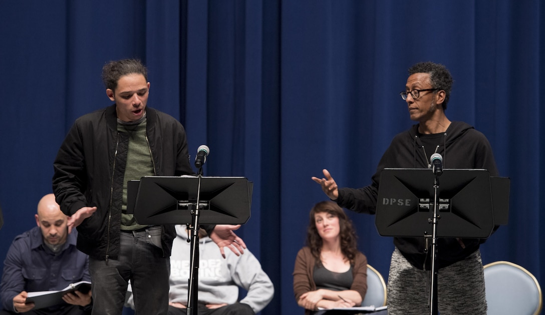 """Anthony Ramos, actor (left), and Andre Royo, actor (right), preform during a scene of, """"Jesus Hopped The 'A' Train,"""" March 20, 2017, at Yokota Air Base, Japan. The performance was brought to Yokota by the Arts in the Armed Forces, an organization who provides free theatre programming for active duty service members, veterans and their families.  (U.S. Air Force photo by Airman 1st Class Donald Hudson)"""