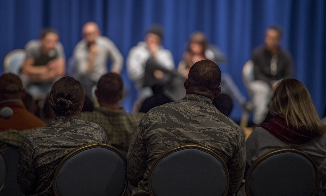 """Military members listen to actors during a Q-and-A session after a performance of, """"Jesus Hopped The 'A' Train,"""" March 20, 2017, at Yokota Air Base, Japan. The performance was brought to Yokota by the Arts in the Armed Forces, an organization who providing free theatre programming for active duty service members, veterans and their families. (U.S. Air Force photo by Airman 1st Class Donald Hudson)"""
