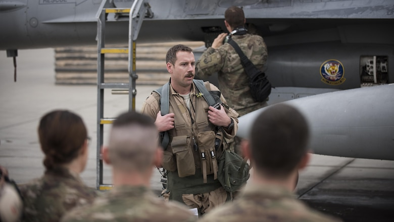 Lt. Col. Craig Andrle, 79th Expeditionary Fighter Squadron commander, speaks to squadron members after flying his 1,000th combat hour March 20, 2017 at Bagram Airfield, Afghanistan. There are only four F-16 Fighting Falcon pilots, lieutenant colonel and below, currently serving in the Air Force who have reached 1,000 combat hours. (U.S. Air Force photo by Staff Sgt. Katherine Spessa)