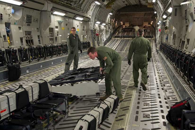 Staff Sgt. Lee Hiott, a loadmaster assigned to the 701st Airlift Squadron, Joint Base Charleston, South Carolina, prepares the aircraft by installing center-row seating prior to departing Charleston to conduct airdrop training with the Wings of Blue parachute team. Citizen Airmen from the 701st Airlift Squadron conducted airdrop training with the Wings of Blue, the U.S. Air Force's parachute jump team, April 1, 2017 in Phoenix, Ariz. (U.S. Air Force photo by TSgt. Bobby Pilch)