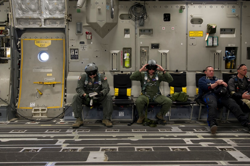 Tech. Sgt. Travis Nettles (left) and Staff Sgt. Lee Hiott (right), loadmasters assigned to the 701st Airlift Squadron, Joint Base Charleston, South Carolina, review checklists and perform equipment checks prior to executing an airdrop with the Wings of Blue. Citizen Airmen from the 701st Airlift Squadron conducted airdrop training with the Wings of Blue, the U.S. Air Force's parachute team, April 1, 2017 in Phoenix, Ariz. (U.S. Air Force photo by TSgt. Bobby Pilch)