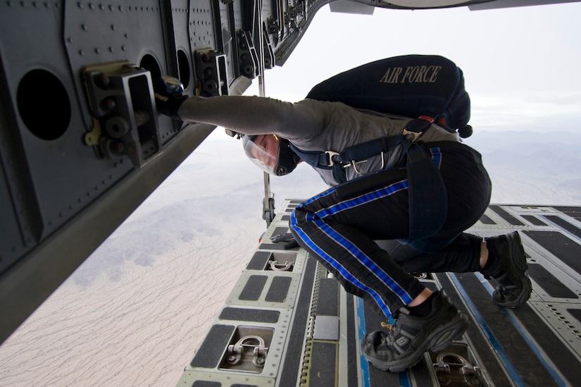 A jumpmaster assigned to the Wings of Blue surveys the jumpzone prior to giving the all-clear for the jumpers to exit the aircraft. Citizen Airmen from the 701st Airlift Squadron conducted airdrop training with the Wings of Blue, the U.S. Air Force's parachute team, April 1, 2017 in Phoenix, Ariz. (U.S. Air Force photo by TSgt. Bobby Pilch)