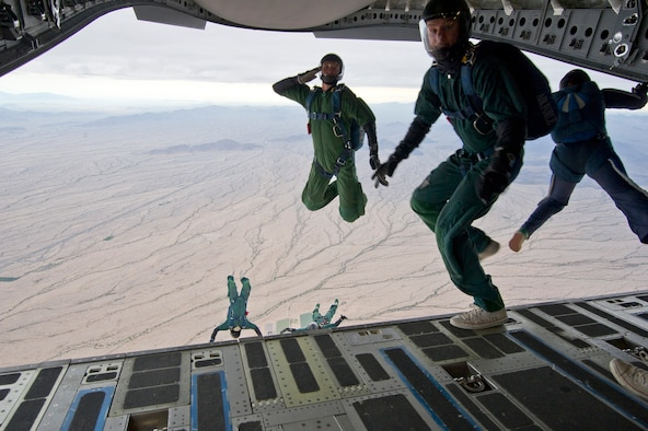 Members from the Wings of Blue and Wings of Green parachute team, depart a Charleston-based C-17 aircraft during their Spring Break training exercise over the Arizona desert. Citizen Airmen from the 701st Airlift Squadron conducted airdrop training with the Wings of Blue, the U.S. Air Force's parachute team, April 1, 2017 in Phoenix, Ariz. (U.S. Air Force photo by TSgt. Bobby Pilch)