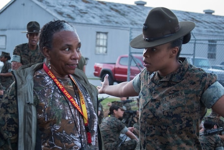 Staff Sergeant Simone King, Senior Drill Instructor, 4th Battalion, Recruit Training Regiment, instructs Elizabeth Sullivan, a counselor at Woodlawn Leadership Academy, during the Recruiting Station Baton Rouge and Jacksonville Educators Workshop aboard Marine Corps Recruit Depot Parris Island, South Carolina, Mar. 29, 2017. The Educators come from Louisiana, Georgia, Mississippi, Florida, and South Carolina to experience this workshop. The workshop allows educators to have an inside look at educational benefits and career opportunities in the Marine Corps to better inform their students. (U.S. Marine Corps photo by Lance Cpl. Jack A. E. Rigsby/Released)