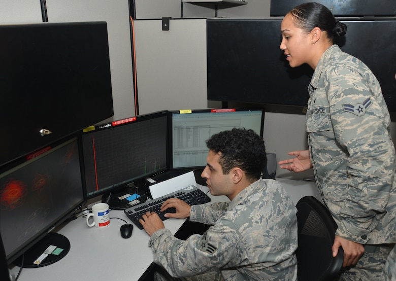 Analysts from the 453rd Electronic Warfare Squadron validate results from an automated flagging process called data-mining March 31, 2017, at Joint Base San Antonio-Lackland, Texas. Data-mining allows analysts to validate automated results rather than manually sifting through all the data.  (U.S. Air Force Photo by Lori Bultman/released)