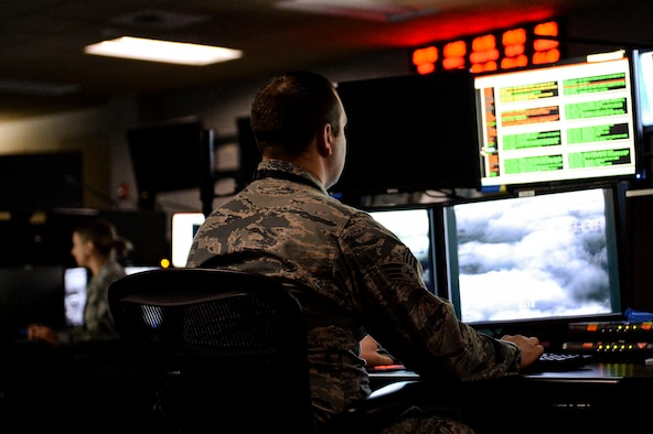 An Airmen from the 480th Intelligence, Surveillance, Reconnaissance Wing perform their jobs at the 480th ISRW at Joint Base Langley-Eustis, Va, Jan 12, 2016. The analytic foundations program requires new analysts to become familiar with the intelligence needs, sources, methods and priorities of the mission prior to entering formal OJT. (U.S. Air Force photo by Senior Airman Nicholas Byers)