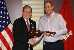 Jimmy Waddle (Right), U.S. Army Corps of Engineers Nashville District Engineering and Construction Division chief, presents a ukulele on behalf of senior leaders to Mike Wilson, Nashville District deputy for Programs and Project Management, honoring his 42 years of federal service during a retirement ceremony at the district headquarters in Nashville, Tenn., March 31, 2017.