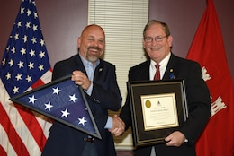 David Bowling (Left), Tennessee Valley Authority vice president of River and Land Operations, presents Mike Wilson with a U.S. Flag flown over the U.S. Capitol Building in Washington D.C., at the request of Congressman John J. Duncan, Jr., 2nd District of Tennessee.  Wilson, U.S. Army Corps of Engineers Nashville District deputy for Programs and Project Management, culminated 42 years of federal service during a ceremony at the district headquarters in Nashville, Tenn., March 31, 2017.