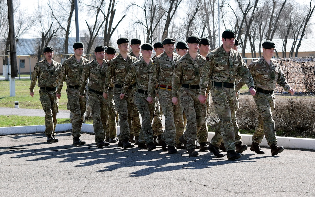 U.K. soldiers with 1st Battalion, The Rifles, 160 Brigade, march onto the parade field during the opening ceremony of Steppe Eagle Koktem, Mar. 31, 2017, at Illisky Training Center, Kazakhstan.