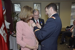 Lt. Col. Stephen Murphy, U.S. Army Corps of Engineers Nashville District commander, pins on U.S. Army Corps of Engineers support pin and takes a moment to thank Cady Wilson for supporting her husband Mike Wilson, Nashville District deputy for Programs and Project Management, during his retirement ceremony at the district headquarters in Nashville, Tenn., March 31, 2017.