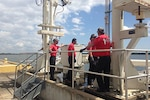Contractor team members conduct a system walkthrough prior to operations at Defense Fuel Support Point Charleston, South Carolina. The facility recently successfully passed an unannounced worst-case scenario oil spill exercise. Courtesy photo