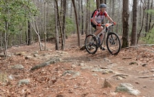 "A mountain bicyclist navigates through ""The Rock Garden"" during the Six Hours of Warrior Creek mountain bike race at the Wilmington District's W. Kerr Scott Dam and Reservoir in Wilkesboro, N.C. (File photo by Hank Heusinkveld)"