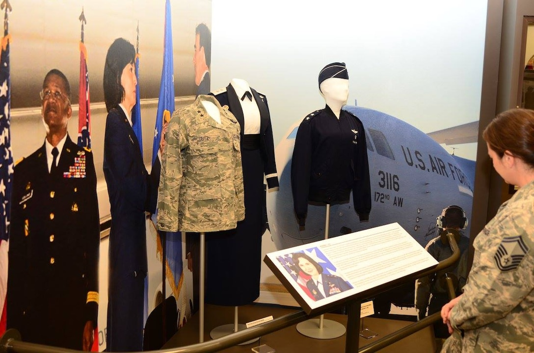 Senior Master Sgt. Audrey Griffon views an exhibit honoring former Mississippi Air National Guard Commander, Major General Catherine Lutz. The display is featured at Camp Shelby's Armed Forces Museum.