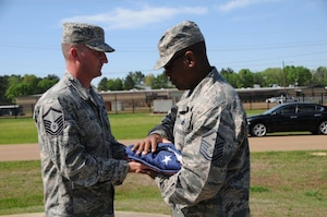 Master Sgt. Michael B. Dill and Master Sgt. Ricky R. Peyton, folds the American Flag during flag detail at Allen C. Thompson Field Air National Guard Base, Jackson, Miss., April 1, 2017. The first sergeants performed evening flag detail to retrieve the flag at the end of the day. (U.S. Air National Guard Photo by Airman 1st Class Kiara N. Spann/Released)