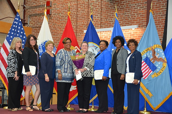 Defense Logistics Agency Finance Richmond Director Barbara Donegan (center) poses with staff members and DLA Finance Richmond Pathways to Career Excellence Program graduates during a graduation ceremony March 30, 2017 on Defense Supply Center Richmond, Virginia.