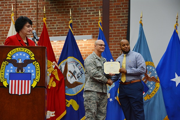 Defense Logistics Agency Aviation Pathways to Career Excellence Program graduate, Albert Dorsey, receives his certificate from Defense Logistics Agency Aviation Commander Air Force Brig. Gen. Allan Day during a ceremony March 30, 2017 on Defense Supply Center Richmond, Virginia. Also pictured is Pam Latker, chief, DLA Human Resources Services, DLA Training Career Management Division.