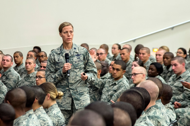 "Lt. Col Meghan Doherty, 326th Training Squadron commander, addresses Airmen during Airmen's Week April 3, 2016, at the Pfingston Reception Center at Joint Base San Antonio-Lackland, Texas. Airmen's Week is a 31-hour, values-based course with a mission to ""develop professional, resilient Airmen, inspired by our heritage, committed to the Air Force core values, and motivated to deliver airpower for America."""