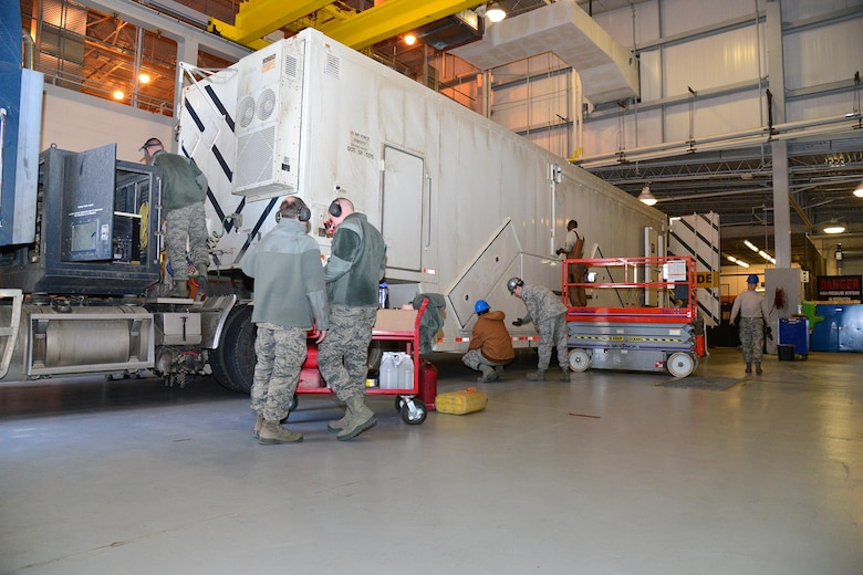 Airmen from the 341st Missile Maintenance Squadron perform maintenance on a payload transporter Feb. 8, 2016, at Malmstrom Air Force Base, Mont. The 341st MMXS is one of many teams that contributed toward the 341st Maintenance Group 2016 Air Force Maintenance Effectiveness Award. (U.S. Air Force photo/Airman First Class Daniel Brosam)