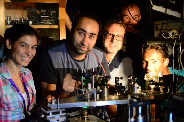 Researchers Catxere Casacio, Waleed Muhammad, Warwick Bowen, Lars Madsen, and Nicholas Mauranyapin perform quantum optics experiments at the Laboratory for Translational Quantum Science, in the Australian Centre for Engineered Quantum Systems, University of Queensland on November 30, 2016. The experiments are being performed broadly to bring to bear techniques from quantum optics on the biological sciences and microscopy, with the goal of enhancing the resolution and speed of biological imaging and sensing.   (Courtesy photo / Erick Romero)