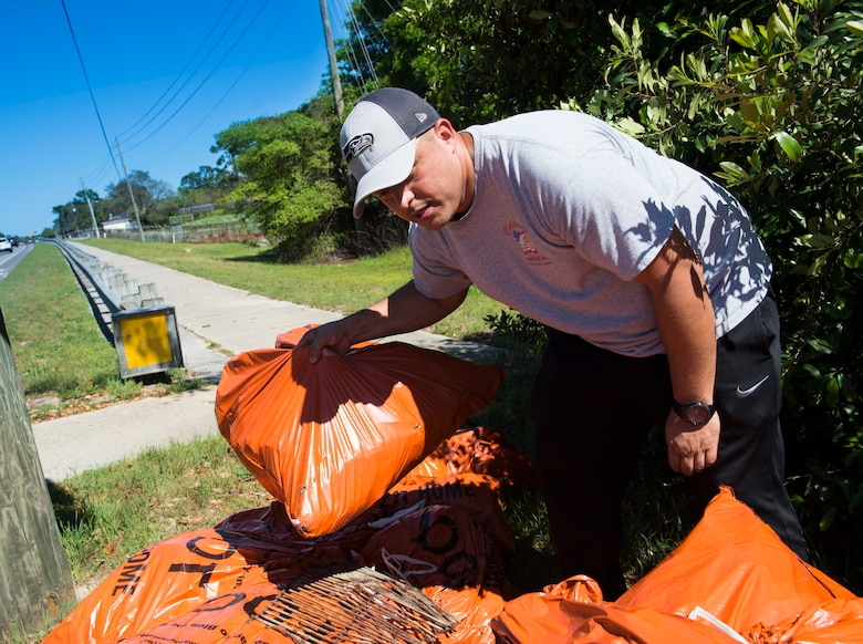 Tech Sgt. Jose Augilar, the chief of aircrew flight equipment flight with the 1st Special Operations Support Squadron, collects trash bags after a highway-cleanup event in Fort Walton Beach, Fla., March 31, 2017. Air Commandos with the 1st SOSS cover a 2.4-mile stretch of highway quarterly picking up trash in an effort to help keep Florida beautiful.  (U.S. Air Force photo by Senior Airman Krystal M. Garrett)