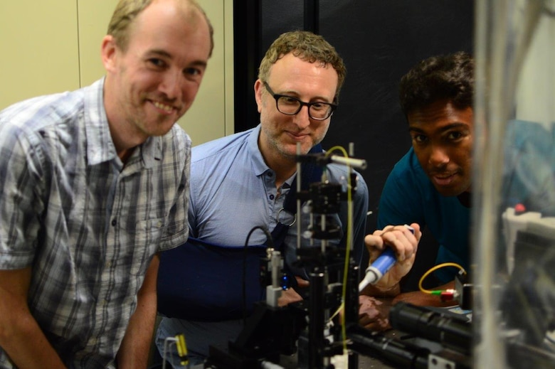 Researchers Lars Madsen, Warwick Bowen, and Nicholas Mauranyapin perform quantum optics experiments at the Laboratory for Translational Quantum Science, in the Australian Centre for Engineered Quantum Systems, University of Queensland on November 30, 2016. The experiments are being performed broadly to bring to bear techniques from quantum optics on the biological sciences and microscopy, with the goal of enhancing the resolution and speed of biological imaging and sensing. (Courtesy photo / Erick Romero)
