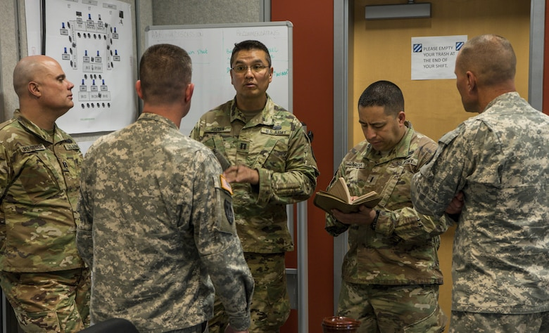 The 317th Military Police Battalion from Tampa, Fla., participate in the Defense Support of Civilian Authority (DSCA) training exercise 'Vigilant Guard' from March 27 to April 2, 2017 at Fort Stewart, Ga. Capt. Winston Holyan and 1st Lt. Tony David Garcia with the 266th Military Police Battalion in the New Mexico National Guard receive tips on executing a Defense Support of Civil Authority (DSCA) training exercise. (U.S. Army Reserve photo by Sgt. Elizabeth Taylor)