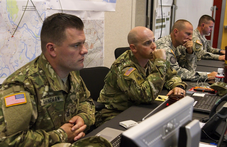 Capt. Christopher Shineman, Capt. Paul Koviuk, Command Sgt. Maj. Fred Waymire and Lt. Col Jack Gray, all with the 317th Military Police Battalion from Tampa, Fla., participate in the Defense Support of Civil Authority (DSCA) training exercise 'Vigilant Guard' from March 27 to April 2, 2017 at Fort Stewart, Ga. The training scenario required U.S Army Reserve and National Guard troops to respond to a category 3 hurricane. (U.S. Army Reserve photo by Sgt. Elizabeth Taylor)