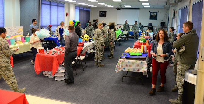 Spectators and competitors gather at the 341st Missile Wing's first cupcake war held April 3, 2017, at Malmstrom Air Force Base, Mont.  The event was attended by approximately 100 Airmen and their families both as spectators and competitors. (U.S. Air Force photo/Senior Airman Magen M. Reeves)