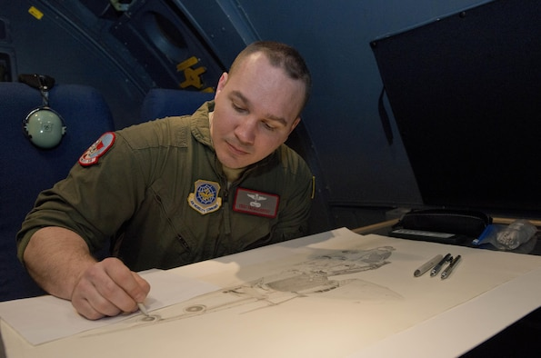 Tech Sgt. Timothy McCarthy, 22nd Airlift Squadron, adds details to a drawing he plans to give to an individual leaving, during some down time on a recent mission to Japan March 3, 2017. McCarthy is a self taught artist who has done drawings and painting throughtout the squadron as well as for going away presents when he's not doing flight engineer duties. (U.S. Air Force photo/Staff Sgt. Nicole Leidholm)