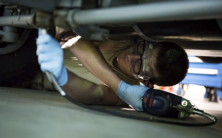 Airman 1st Class Jonathan Lake, 113th Maintenance Squadron aerospace ground equipment apprentice, tightens a bolt on an air conditioning unit at Joint Base Andrews, Md., March 27, 2017. The D.C. Air National Guard has various missions including defending the National Capital Region, supporting the District and local communities during special security events and natural disasters, and maintaining a worldwide deployable fighter and support force. (U.S. Air Force photo by Airman 1st Class Gabrielle Spalding)