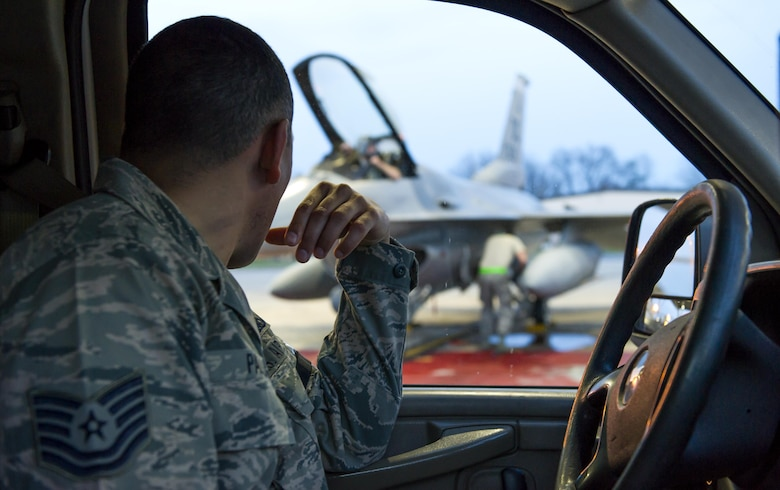 Tech. Sgt. Alberto Padilla, 113th Maintenance Squadron flightline expediter, oversees a maintenance Airman working on an F-16 Fighting Falcon at Joint Base Andrews, Md., March 27, 2017. As a flightline expediter, Padilla must accurately manage, control and direct resources to accomplish maintenance needs. He also reports to the production superintendent so they can accurately determine things like aircraft availability. (U.S. Air Force photo by Airman 1st Class Gabrielle Spalding)
