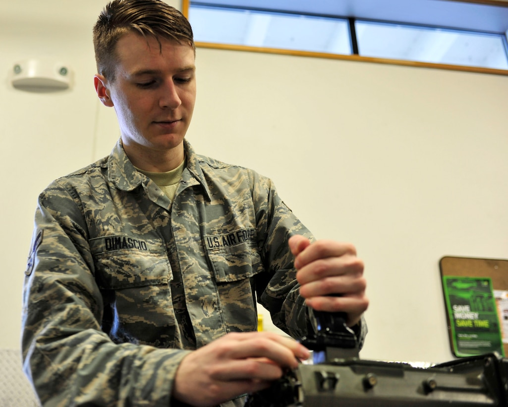 Airman 1st Class Sabatino DiMascio, 62nd Aircraft Maintenance Squadron communication/navigation mission systems specialist, performs functions checks on equipment March 29, 2017 on the flightline at McChord Field, Wash. While on duty, DiMascio works on electronics and avionics such as radios, GPS and anti-missile defense systems; off duty, he is a member of the pit-crew at a Washington speedway. (U.S. Air Force photo/Staff Sgt. Whitney Amstutz)