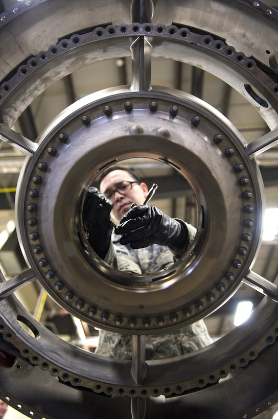 Staff Sgt. James Winn, 113th Maintenance Squadron aerospace propulsion technician, performs phase maintenance on the fan frame of an F-16 Fighting Falcon engine at Joint Base Andrews, Md., March 27, 2017. The F-16 must go through different inspections to ensure the quality and safety of the aircraft for mission readiness. In this case, the aerospace propulsion technicians are responsible for the tear down, inspection and build-up of F-16 engines after 4,000 flight hours. (U.S. Air Force photo by Airman 1st Class Gabrielle Spalding)