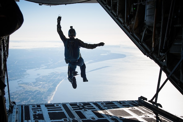A member of the U.S. Navy Leap Frogs jumps from an 815th Airlift Squadron C-130J Super Hercules aircraft  April 4. The Leap Frogs coordinated with the Flying Jennies to complete this jump and several others out of Keesler Air Force Base, Mississippi as joint training for both groups, which was also in conjunction with Navy Week and the Mississippi bicentennial celebration. (U.S. Air Force photo/Staff Sgt. Heather Heiney)