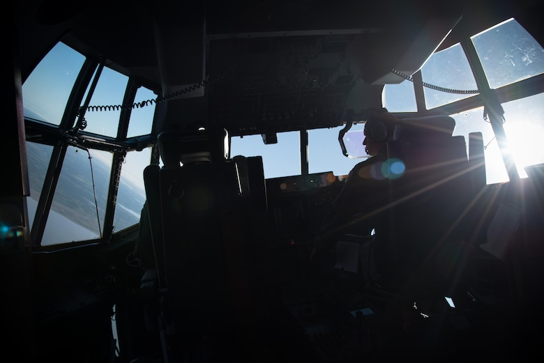 Capt. Nick Foreman and Capt. Jason Rimmer, 815th Airlift Squadron pilots, fly a C-130J Super Hercules aircraft April 4 during a jump mission with the U.S. Navy Leap Frogs. The Leap Frogs coordinated with the Flying Jennies to complete this jump and several others out of Keesler Air Force Base, Mississippi as joint training for both groups, which was also in conjunction with Navy Week and the Mississippi bicentennial celebration.  (U.S. Air Force photo/Staff Sgt. Heather Heiney)