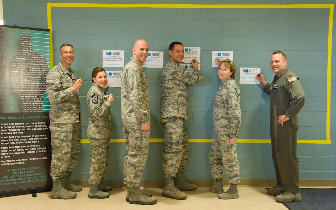 Team Dover senior leadership kicks off Sexual Assault Awareness Month by placing their campaign poster with a personal message on the graffiti wall March 31, 2017 at the Fitness Center on Dover Air Force Base, Del. Pictured left to right are Col. Randy Boswell, 436th Mission Support Group commander; Chief Master Sgt. Sarah Sparks, 436th Airlift Wing command chief; Col. Tyler Knack, 436th Maintenance Group commander; Col. Ethan Griffin, 436th AW commander; Col. Kathy Weiss, 436th Medical Group commander; and Col. Doug Hall, 436th Operations Group commander. Over 150 campaign posters were placed on the wall by the end of the first day. (U.S. Air Force photo by Roland Balik)