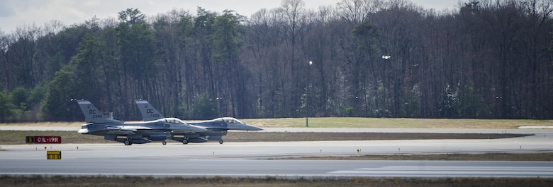 Two F-16 Fighting Falcon's wait to take off during an alert scramble at Joint Base Andrews, Md., March 28, 2017. A scramble is a rapid response to any air defense operation and air emergency. The 113th Aerospace Control Alert facility has more than double the number of alert events than all other active duty and National Guard bases combined. (U.S. Air Force photo by Airman 1st Class Gabrielle Spalding)