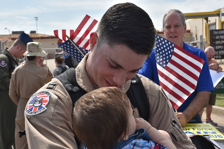 Nearly 250 members of the 965th Airborne Air Control Squadron returned to Tinker Air Force Base March 21, following their deployment to Southwest Asia in support of Operation Inherent Resolve. Hundreds of family members and squadron team mates were on hand to greet the returning warriors. (Air Force  photo by Ron Mullan)
