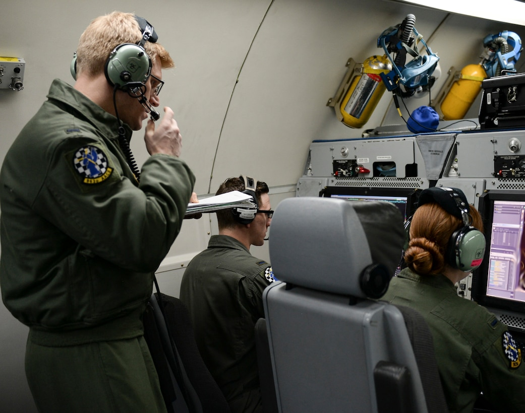Members of the 963rd Airborne Air Control Squadron monitor air operations, March 15, while flying over the Pacific Northwest. The 963rd AACS is assigned to Tinker, and came to Mountain Home AFB to participate in the Gunfighter Flag exercise. (Air Force photo by Senior Airman Jessica H. Smith)