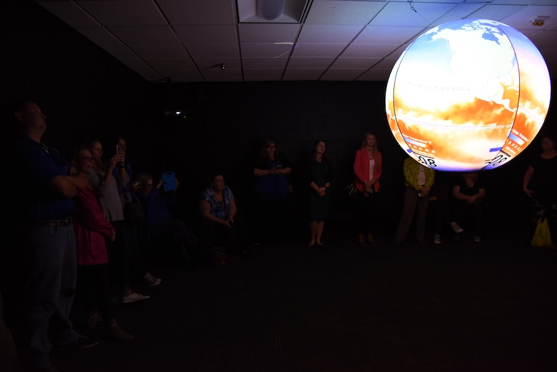 Educators receive a Science on a Sphere demonstration at the Weather Training Complex during a NASA Educator Workshop, March 30, 2017, on Keesler Air Force Base, Miss. NASA teamed up with 335th Training Squadron weather instructors and the 403rd Wing Hurricane Hunters to provide teachers from Mississippi and Louisiana with available resources, techniques and best practices for use in their classrooms. (U.S. Air Force photo by Kemberly Groue)